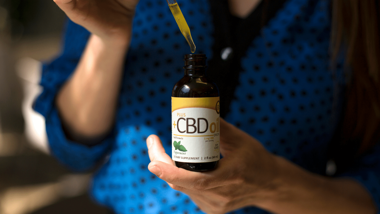 plus-cbd-oil-drops-in-use