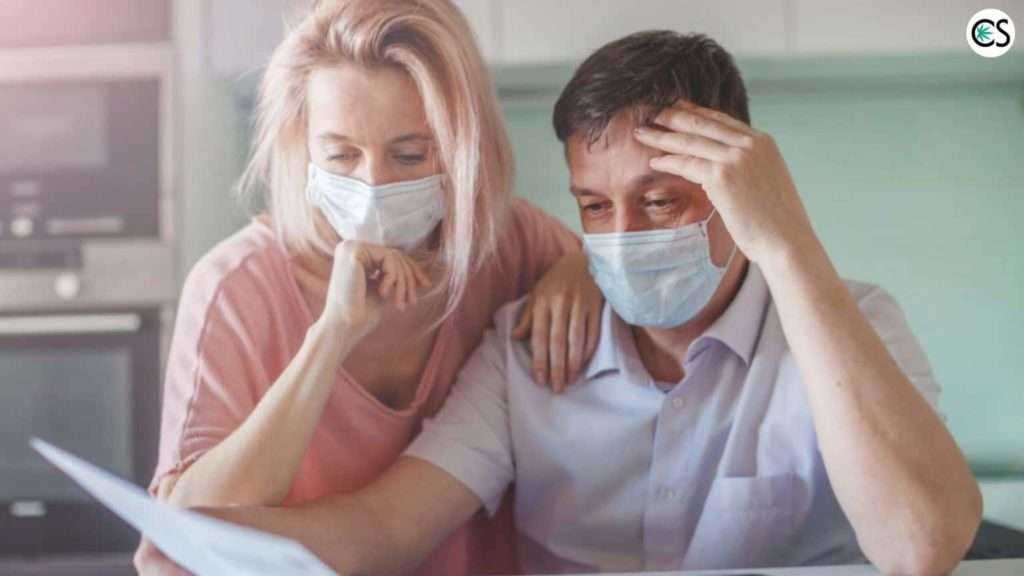 woman and man in virus mask